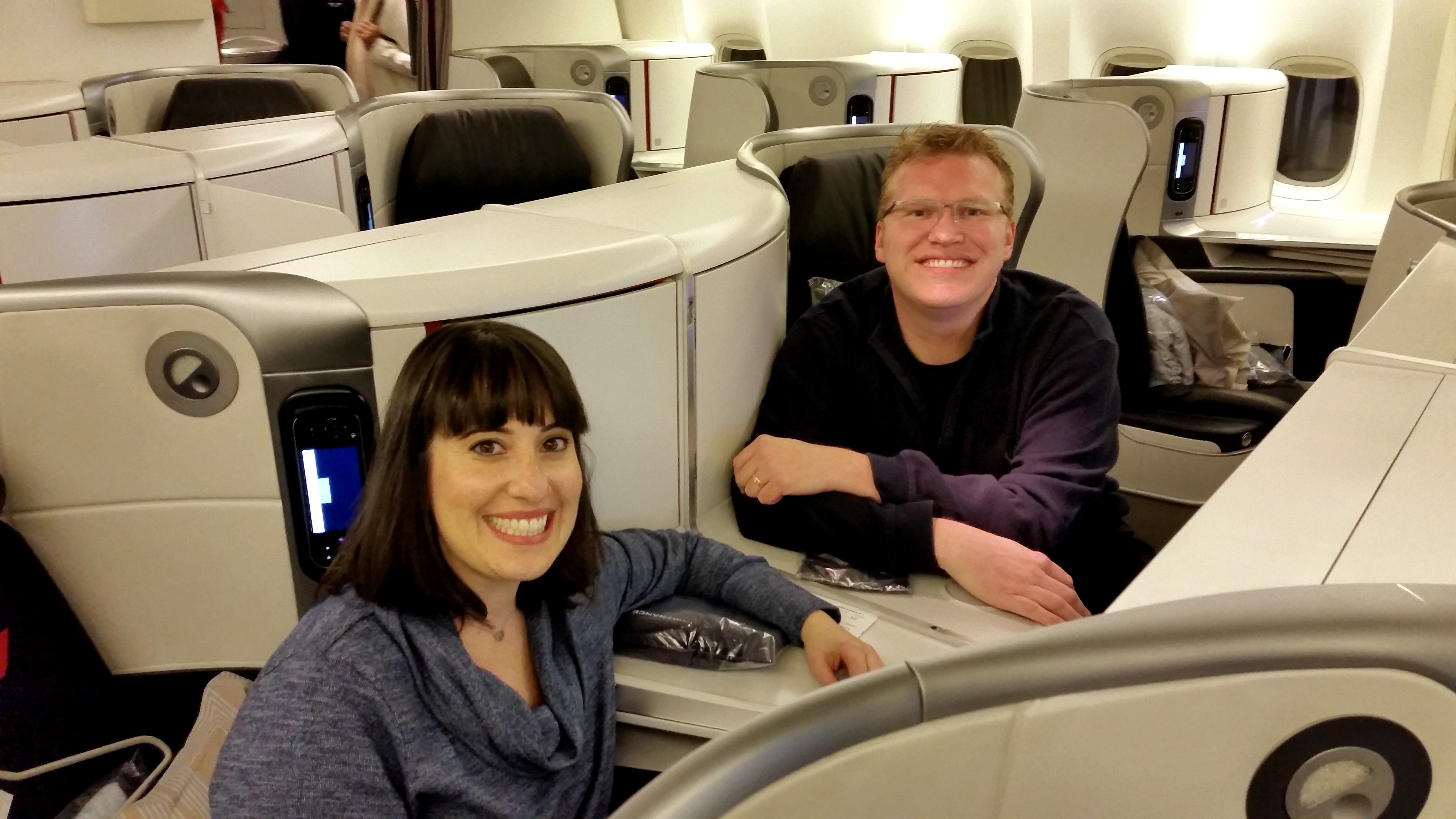 PointsLounge founder Chris Carley and his wife Randee sitting in business class on an Air France 777.