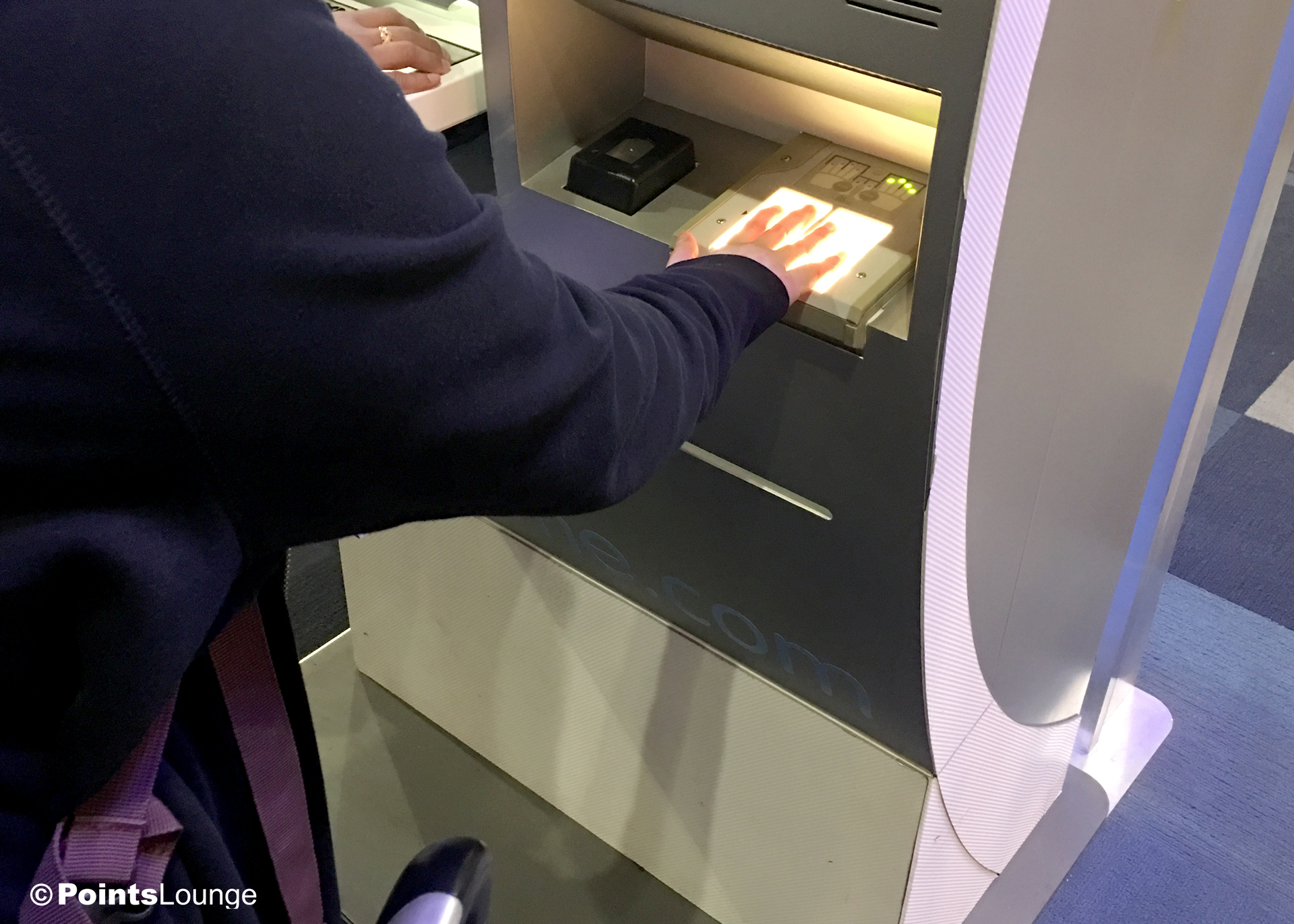 A new CLEAR member has her fingerprints scanned the CLEAR enrollment center at Las Vegas McCarran Airport.