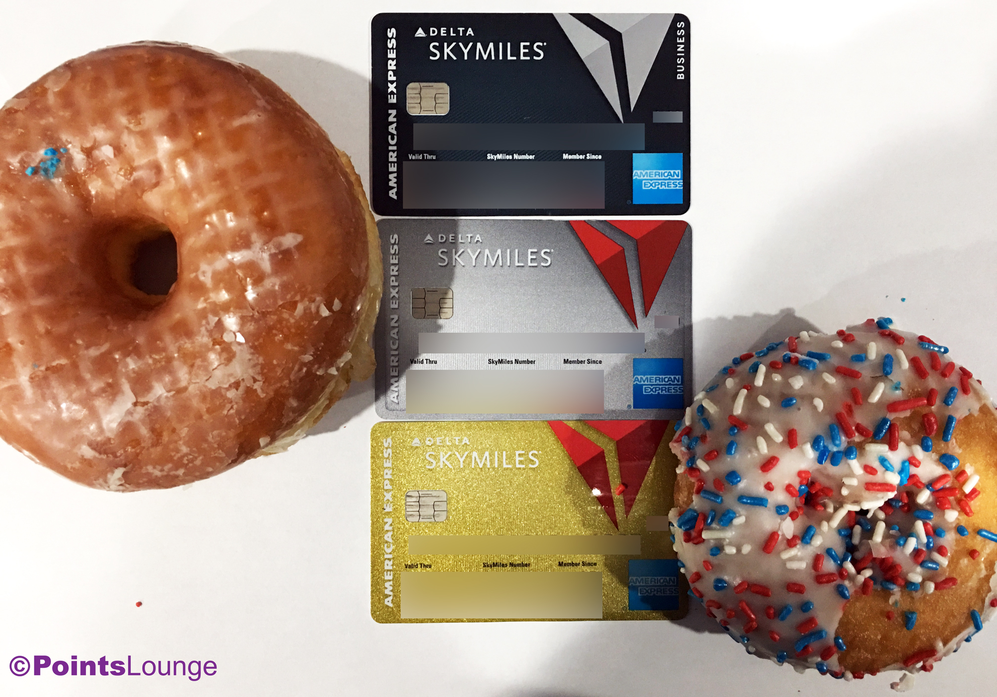 Doughnuts surround Delta American Express credit cards.