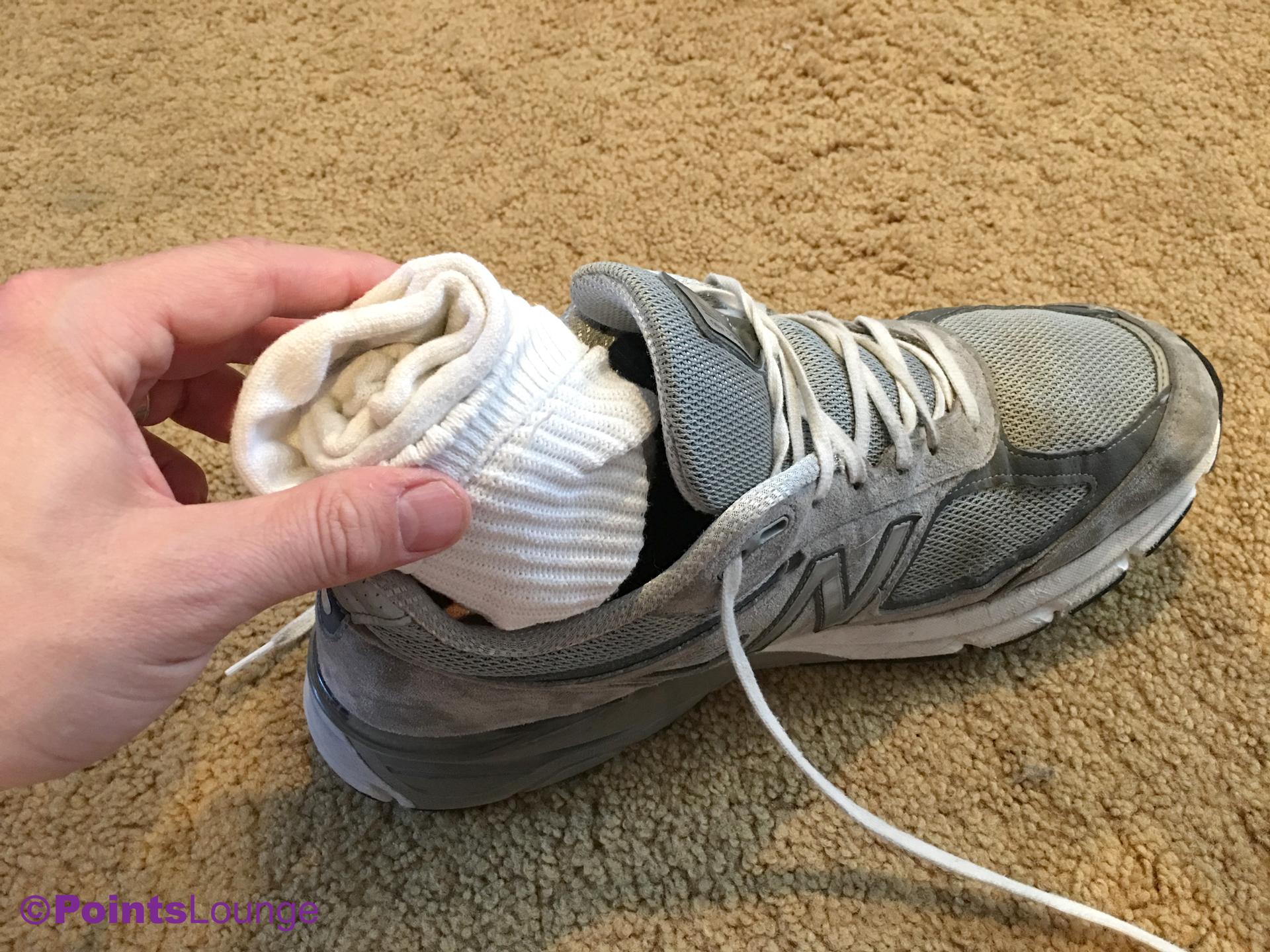 Placing sock balls into a pair of shoes (New Balance M990GL4 Grey/Castlerock)