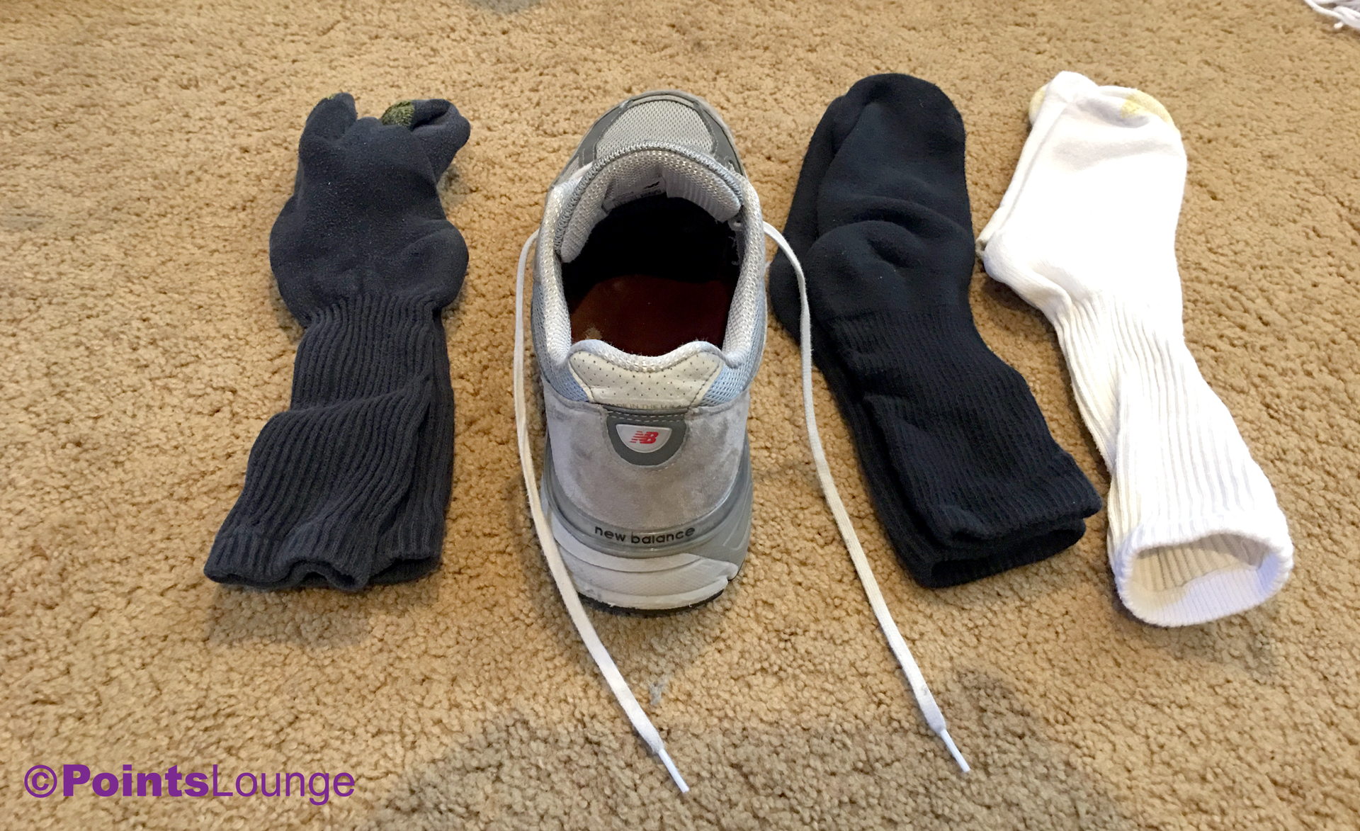 Three pairs of socks and a shoe (New Balance M990GL4)