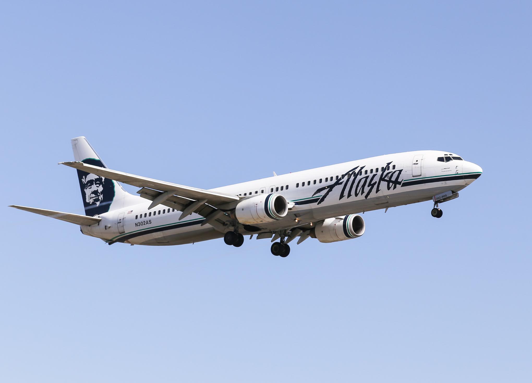 Los Angeles, USA - June 6, 2014: An airplane of Alaska Airlines landing at Los Angeles International Airport.