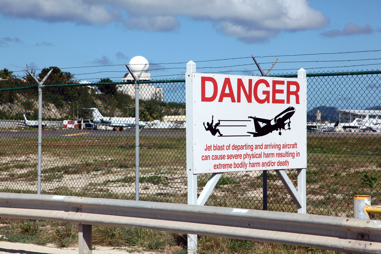 A sign between Maho Beach and St. Maarten's Princess Juliana Airport warns people of jet blast from departing and arriving aircraft.