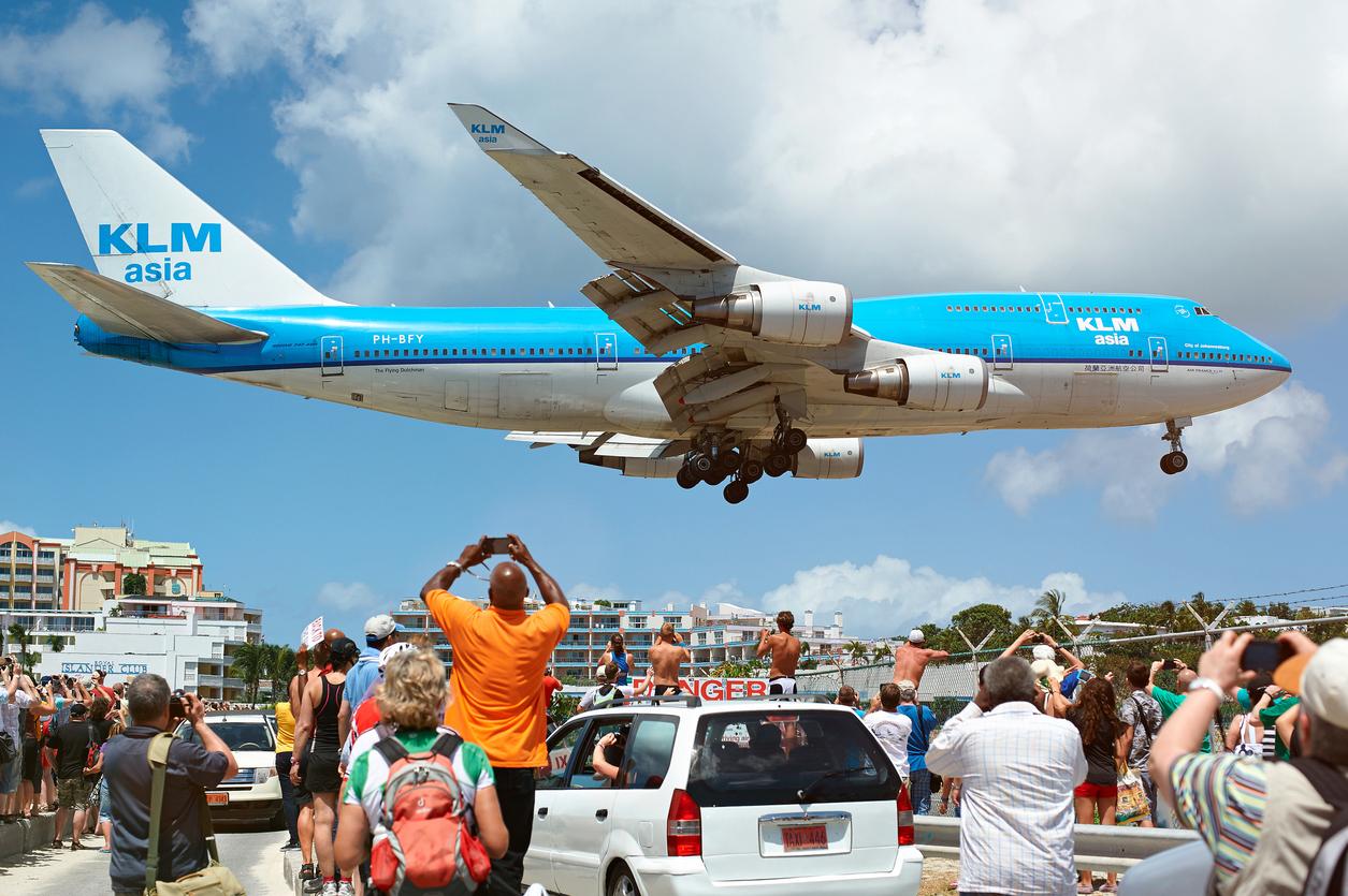 A KLM 747 flies over Maho Beach before landing at St. Maarten's Princess Juliana Airport.