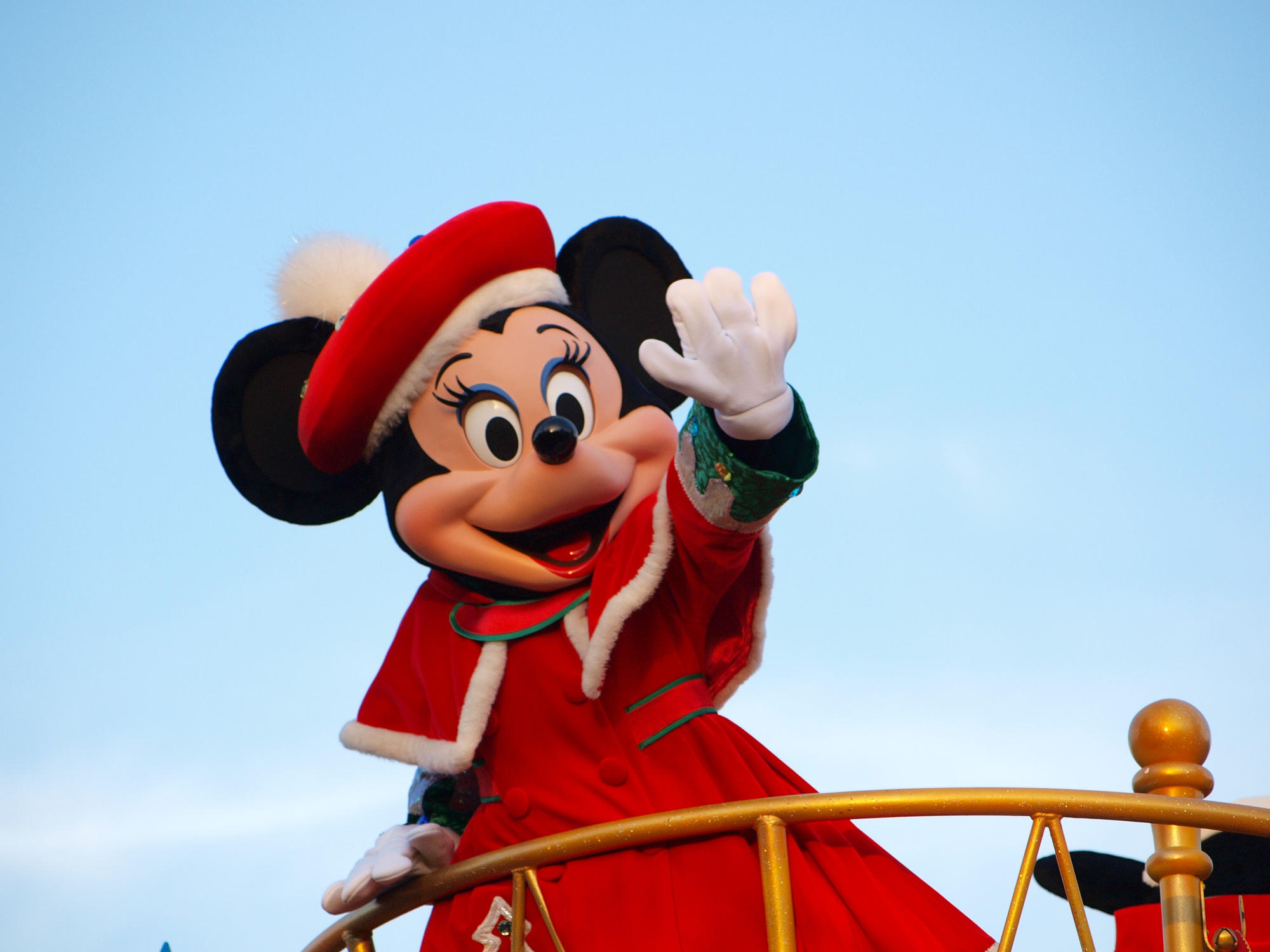 Tokyo, Japan - December 14, 2012: Minnie Mouse in the red coat waving her hand in daytime Parade at Tokyo-Disneyland, Tokyo, Japan.