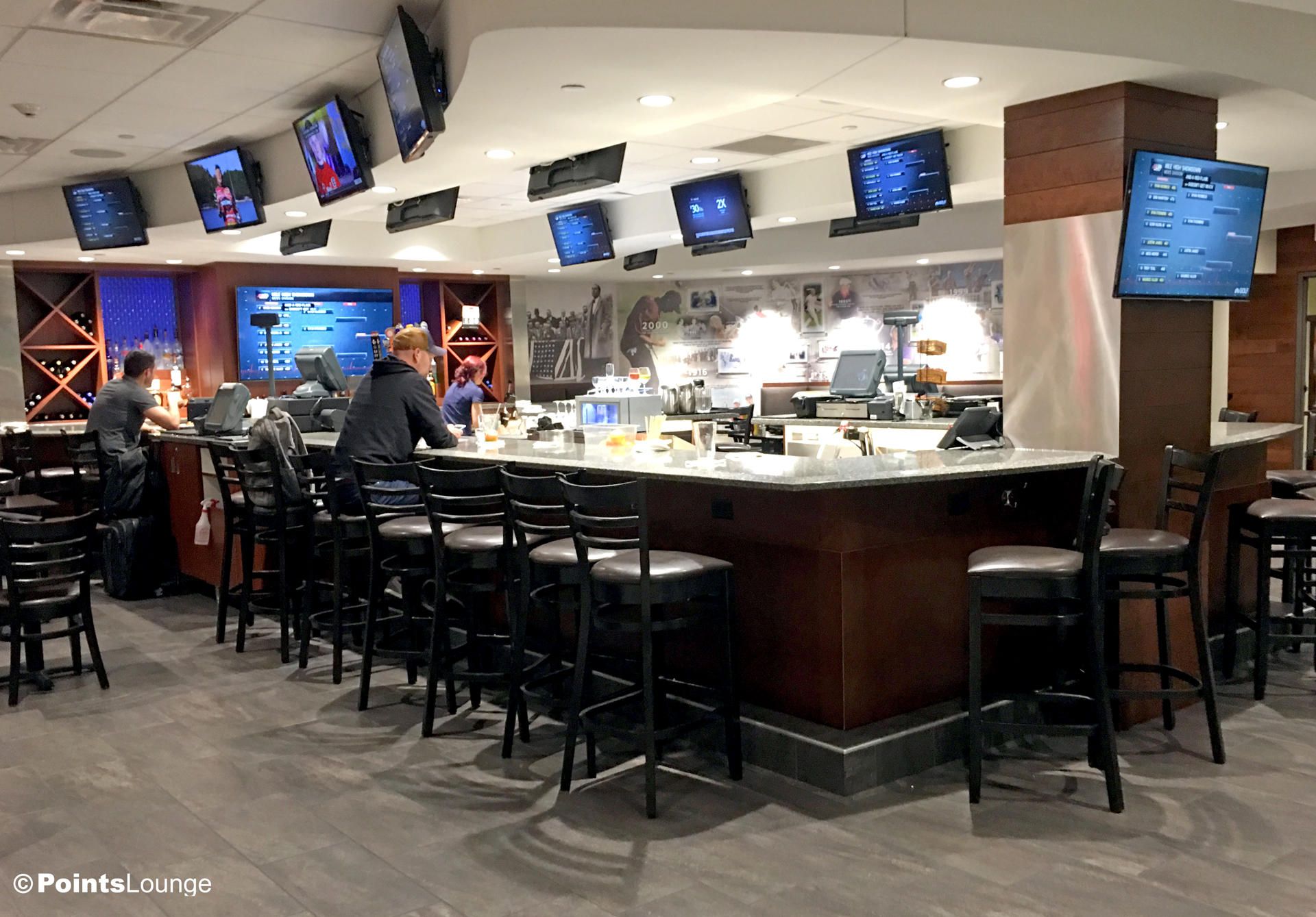 A view of Champions' Grille and bar at the PGA MSP golf-themed airport lounge at the Minneapolis-St. Paul International Airport. One of the ways the lounge can be accessed is with Priority Pass membership. (Click for a larger image.)