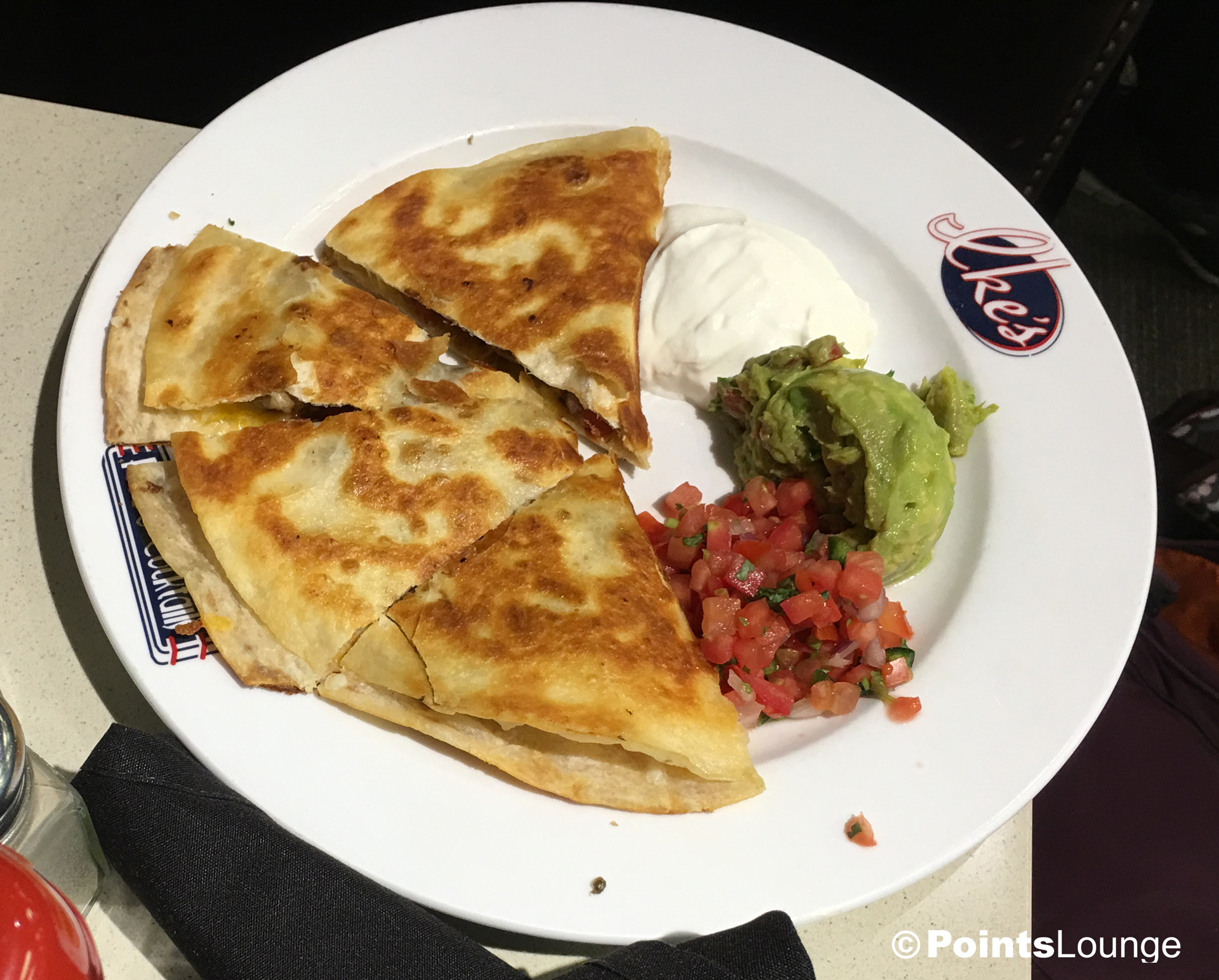A view of Ike's Quesadilla from the Champions' Grille inside the PGA MSP golf-themed airport lounge at the Minneapolis-St. Paul International Airport. One of the ways the lounge can be accessed is with Priority Pass membership. (Click for a larger image.)