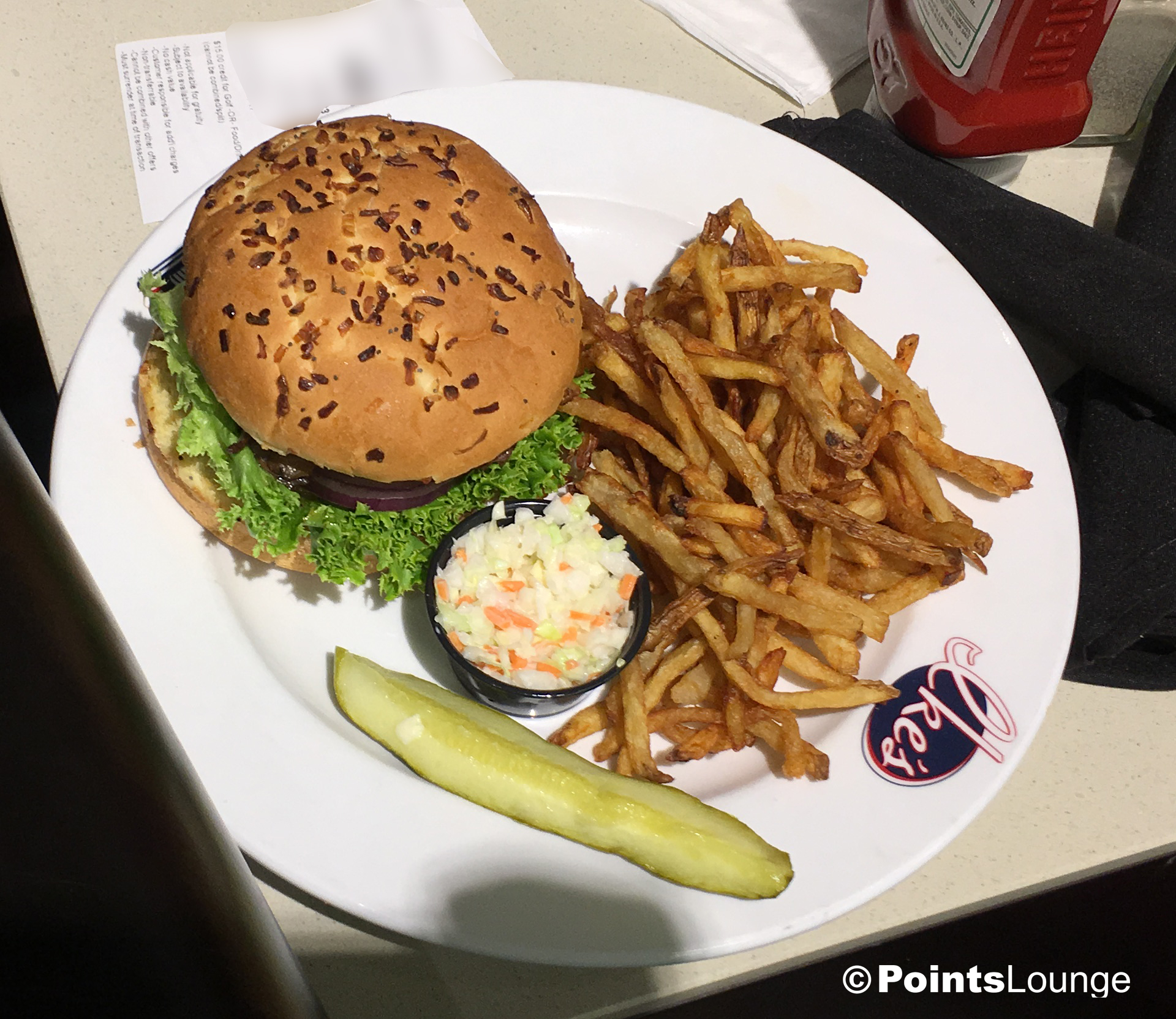 A view of Ike's Wine Soaked Mushroom and Swiss Burger from the Champions' Grille inside the PGA MSP golf-themed airport lounge at the Minneapolis-St. Paul International Airport. One of the ways the lounge can be accessed is with Priority Pass membership. (Click for a larger image.)