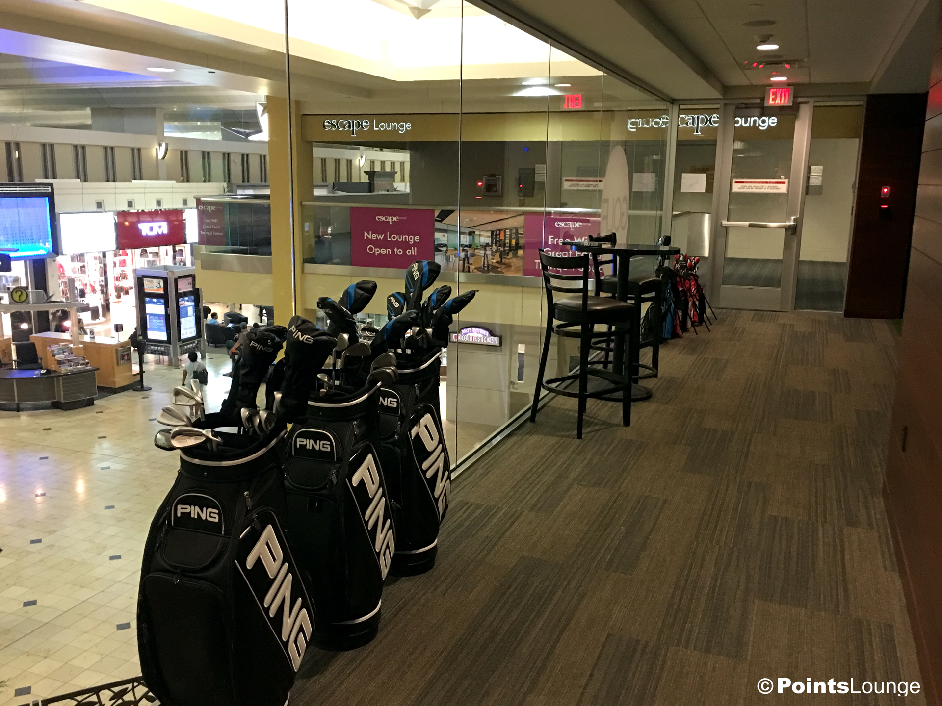 Ping golf clubs and bags are displayed inside the PGA MSP golf-themed airport lounge at the Minneapolis-St. Paul International Airport. One of the ways the lounge can be accessed is with Priority Pass membership. (Click for a larger image.)