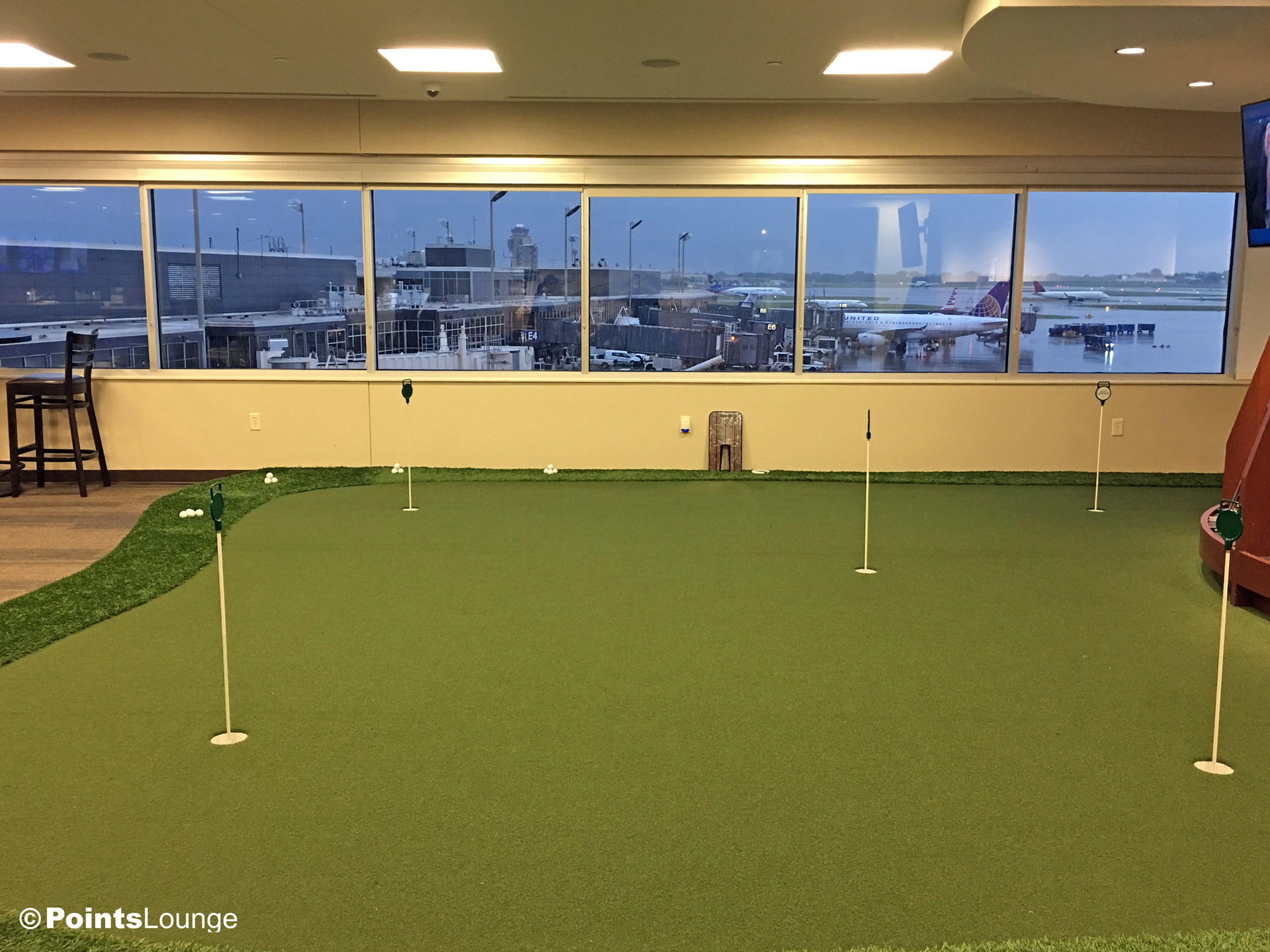 A view of the E concourse at MSP airport and a putting green as seen from inside the PGA MSP golf-themed airport lounge at the Minneapolis-St. Paul International Airport. One of the ways the lounge can be accessed is with Priority Pass membership. (Click for a larger image.)