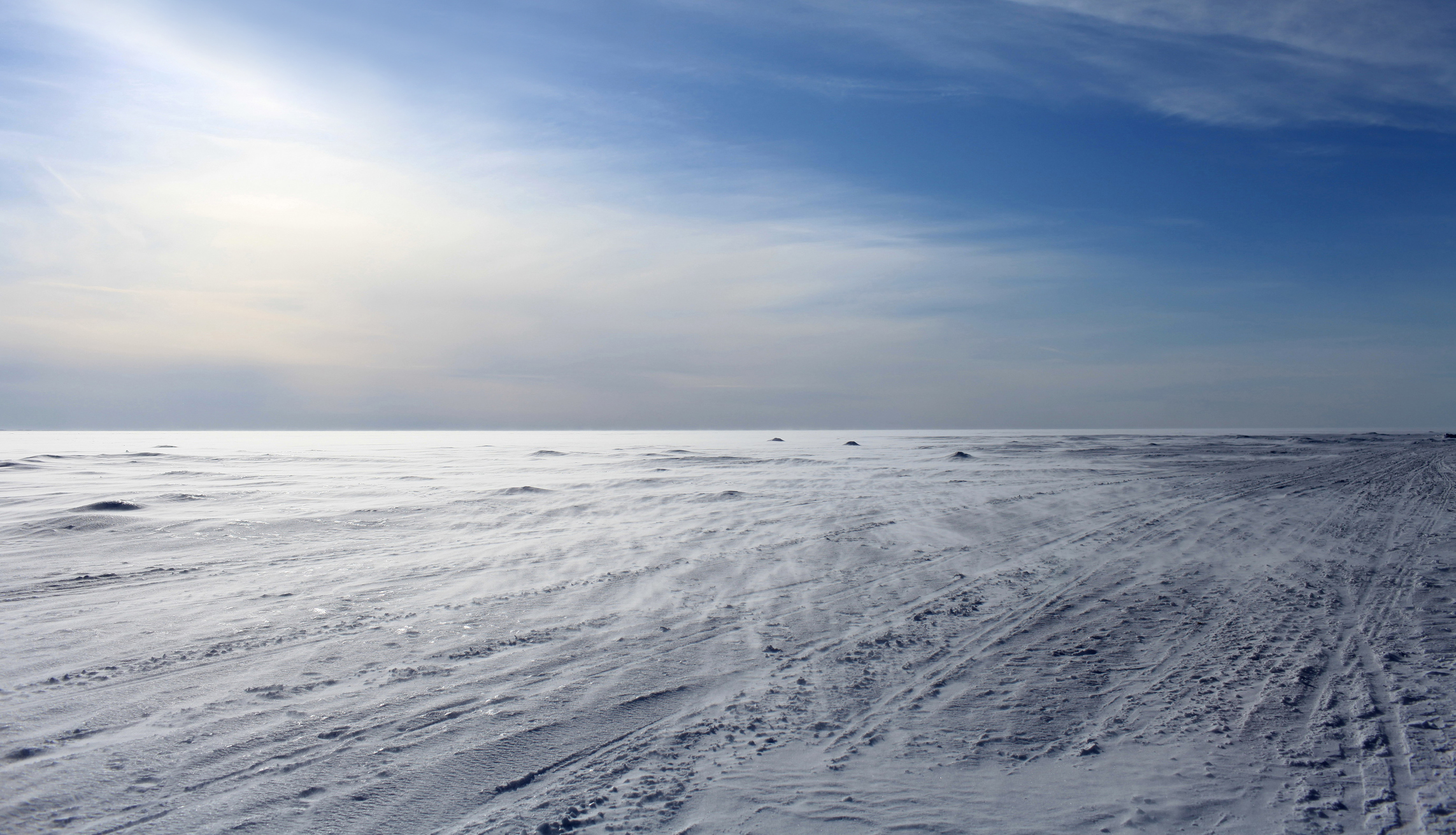 Stock image of a wind frozen sea looking like a white snowy desert. (Photo: ©iStockphoto.com/iv-serg)