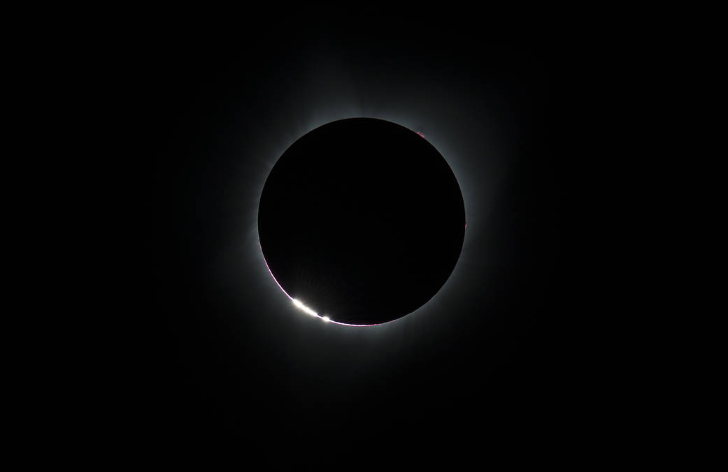 The Bailey's Beads effect is seen as the moon makes its final move over the sun during the total solar eclipse on Monday, August 21, 2017 above Madras, Oregon. A total solar eclipse swept across a narrow portion of the contiguous United States from Lincoln Beach, Oregon to Charleston, South Carolina. A partial solar eclipse was visible across the entire North American continent along with parts of South America, Africa, and Europe. Photo Credit: (NASA/Aubrey Gemignani) (Photo: NASA/Aubrey Gemignani)